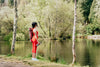 looking out at a pond while wearing athletic wear