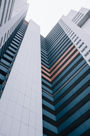 looking up at modern city building