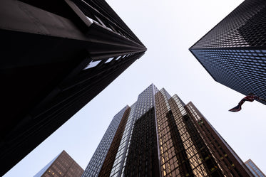 looking up at three buildings