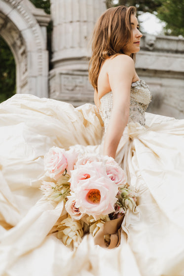 low angle of bride holding flowers