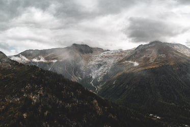 low clouds cascading over mountains and a valley