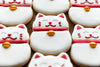 lucky cat cookies on display