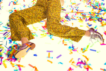 lying in technicolor, surrounded by confetti