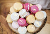 macarons piled up in a high pile