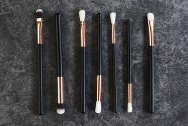 makeup brushes in a line