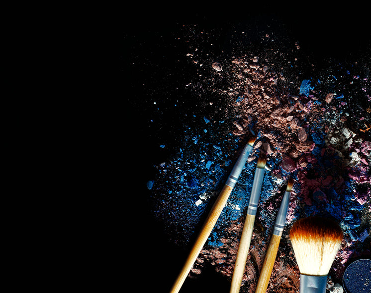 Makeup Brushes With Nude And Blue Powders
