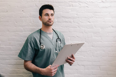 male doctor holding clipboard