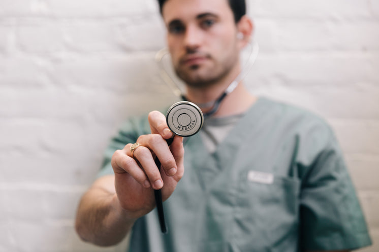 Male Doctor Holding Out Stethoscope