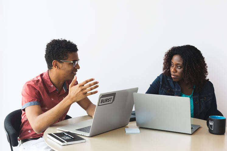 Man and Woman Brainstorming with Laptops