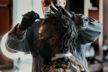 man getting a hair cut at local barber