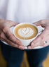 Free Man Holding A Latte Photo — High Res Pictures