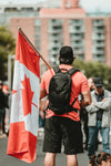 man in a crown holding a canadian flag