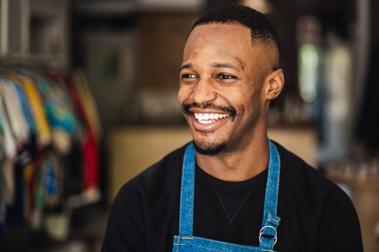 Man In Retail Store With Big Smile
