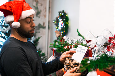 man opening student loan payment gift