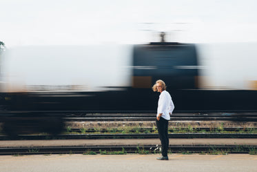 man standing by train