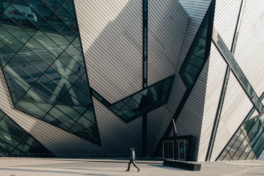 man walking in front of modern building
