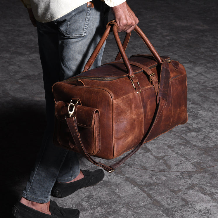 Man Walking With A Leather Travel Bag.