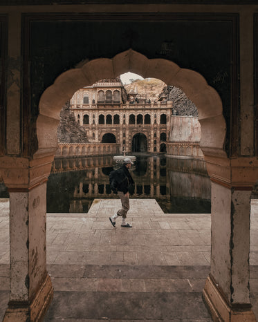man walks around galta ji temple