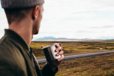 man watching the road landscape