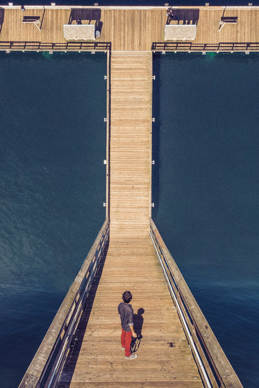 man with camera stood on a dock