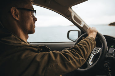 man with glasses driving