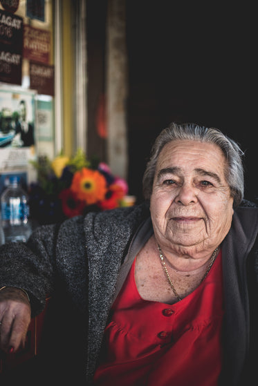 mature woman sitting outside of restaurant