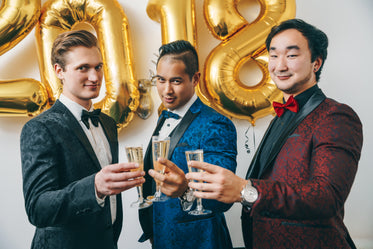 men in tuxedos cheers nye