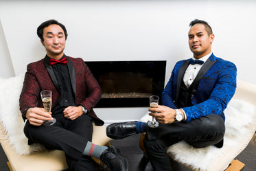 men in tuxedos with champagne