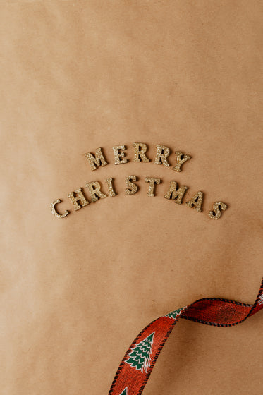 merry christmas spelled out in gold letters