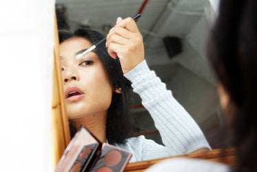 mirror view of putting on makeup