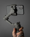 mobile phone and gimbal in hand