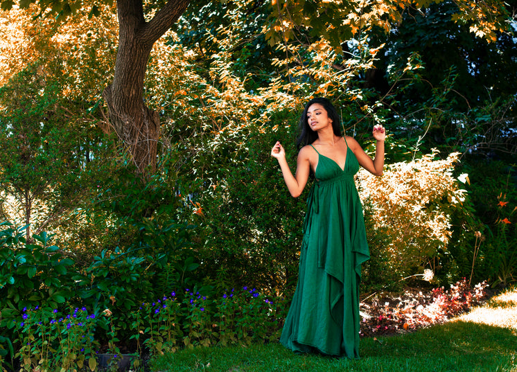 Model Poses In Long Green Maxi Dress