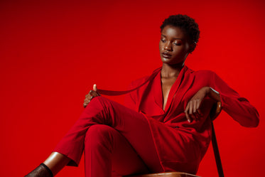 model poses in red pansuit