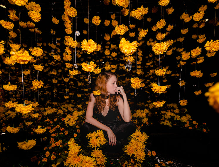 Model Poses With Hanging Flowers