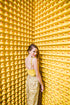 model posing coyly with hundreds of rubber ducks