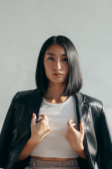 model with leather jacket over shoulders