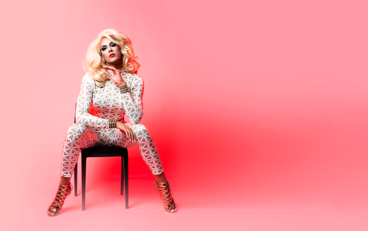 Drag Queen Posing In Chair