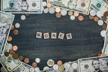 money letter tiles and coin