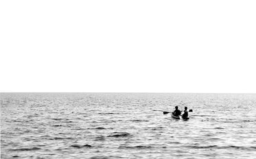 monochrome image of a small boat on open water