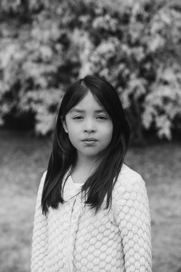 moody portrait of a child in black and white