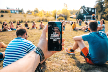motivational message on mobile at outdoor event