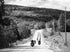 motorcycle caravan rides hillside in black and white