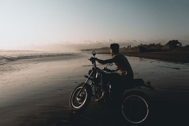 motorcycle on wet beach sands