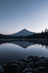 mount hood with calm lake reflection
