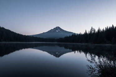 mountain by glassy lake with reflection