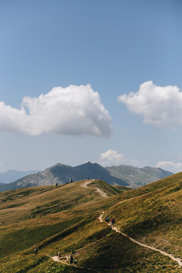 mountains and hikers on a pathway
