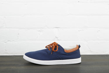 navy blue and white left shoe