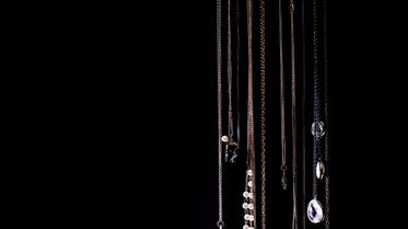 necklaces hanging on black