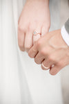 newly weds hold hands close up