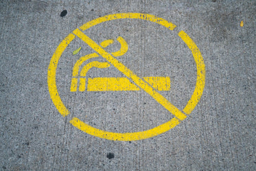 no smoking sign on sidewalk